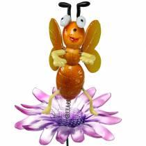 Kukkamehiläisen kukassa metallijouset oranssi, violetti H74cm